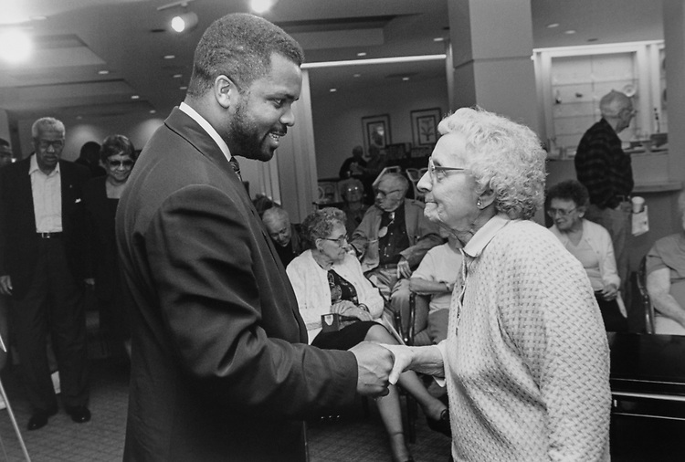 Rep. Jesse Jackson, D-Ill., shakes hands with an elderly lady of Waterford Estates Retirement Centre in South Chicago on Nov. 27, 1995. (Photo by Laura Patterson/CQ Roll Call)