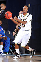 12 November 2010:  FIU's DeJuan Wright (14) handles the ball in the first half as the FIU Golden Panthers defeated the Florida Memorial Lions, 89-73, at the U.S. Century Bank Arena in Miami, Florida.