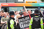 © Joel Goodman - 07973 332324 - all rights reserved . 05/06/2010 . Cardiff , UK . The Welsh Defence League (an offshoot of the English Defence League ) hold a march and rally in Cardiff , opposed by anti-fascist groups including Unite Against Fascism . Photo credit : Joel Goodman