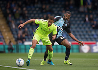 Jake Carroll of Hartlepool United shields the ball from Janoi Donacien of Wycombe Wanderers during the Sky Bet League 2 match between Wycombe Wanderers and Hartlepool United at Adams Park, High Wycombe, England on 5 September 2015. Photo by Andy Rowland.