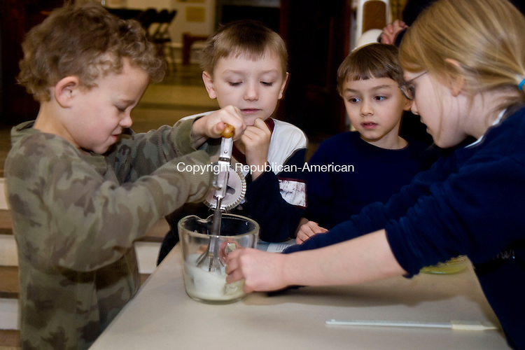 LITCHFIELD, CT - 26 JANUARY 2010 -012610JT06--<br /> FOR COUNTRY LIFE: From left, Noah Johansson, 7, of Winsted, helps make snowball cookies with Zach Helm, 7, of Torrington, Nico Wenis, 6, of Woodbury, and Katie Fraziene, 8, during Litchfield History Museum's program on Litchfield's past on Tuesday, Jan. 26. The event also featured baking snowball cookies, songs, and making crystals.<br /> Josalee Thrift Republican-American