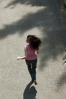 Young woman running, high angle view