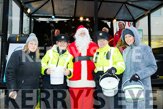 The annual Tralee Garda Christmas collection for this years chosen charity, Recovery Haven, took place in the Mall, Tralee last Wednesday Dec 18, and singing along were L-R Garda Liz Twomey and Grd Mary Gardiner, Santa Claus, Garda Cathy Murphy with Grd Cecelia Scanlon.