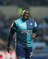 Adebayo Akinfenwa of Wycombe Wanderers smiles as a section of Coventry supporters shout abuse during the The Checkatrade Trophy - EFL Trophy Semi Final match between Coventry City and Wycombe Wanderers at the Ricoh Arena, Coventry, England on 7 February 2017. Photo by Andy Rowland.