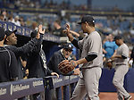Masahiro Tanaka (Yankees),<br /> APRIL 18, 2015 - MLB :<br /> Masahiro Tanaka of the New York Yankees high-fives his teammates in the dugout during the Major League Baseball game against the Tampa Bay Rays at Tropicana Field in St. Petersburg, Florida, United States. (Photo by AFLO)