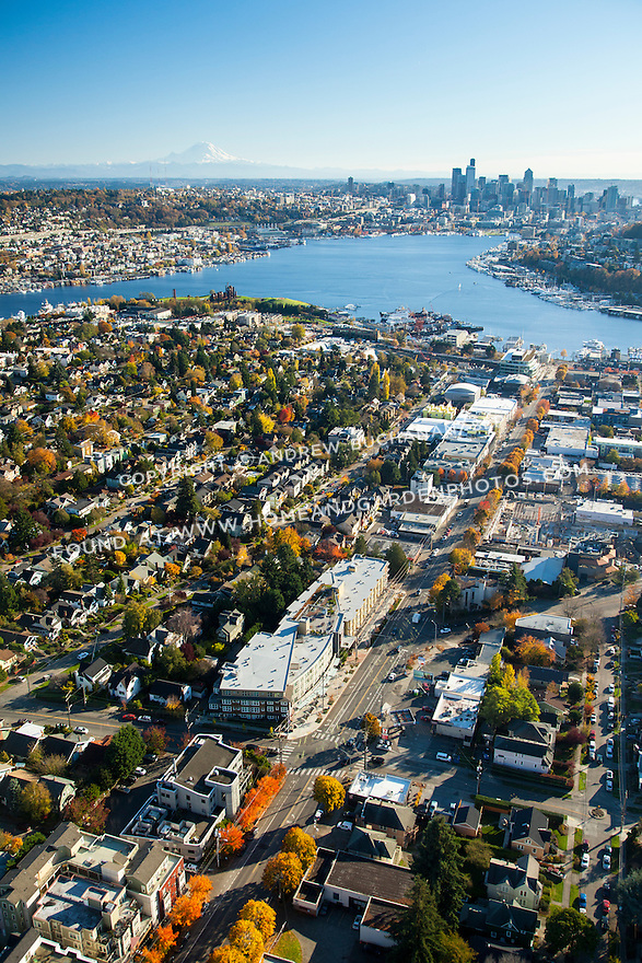 Aerial view of Seattle's Wallingford neighborhood and Lake Union with downtown skyline and Mount Rainier in the background
