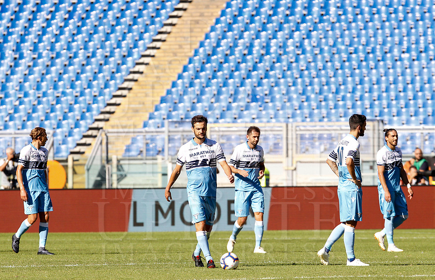 Lazio's players, from left, Lucas Leiva, Marco Parolo, Senad Lulic, Luis Alberto and Martin Caceres react after Roma scored during the Italian Serie A football match between Roma and Lazio at Rome's Olympic stadium, September 29, 2018. Roma won 3-1.<br /> UPDATE IMAGES PRESS/Riccardo De Luca
