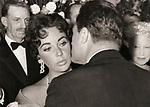 "Elizabeth Taylor and Michael Todd at the premiere of ""Around the World in 80 Days"" February 1957."