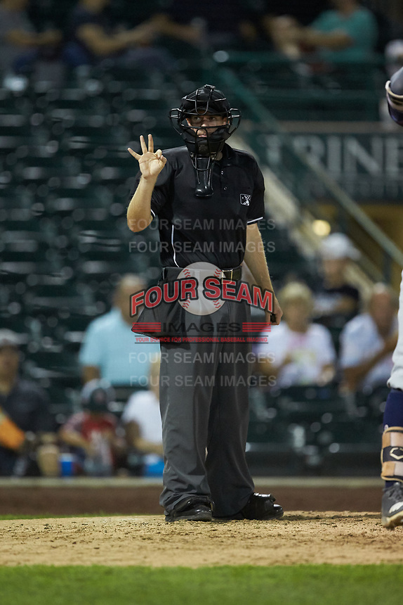 Home plate umpire A.J. Choc indicates he needs three new baseballs during the Midwest League game between the Bowling Green Hot Rods and the Fort Wayne TinCaps at Parkview Field on August 20, 2019 in Fort Wayne, Indiana. The Hot Rods defeated the TinCaps 6-5. (Brian Westerholt/Four Seam Images)