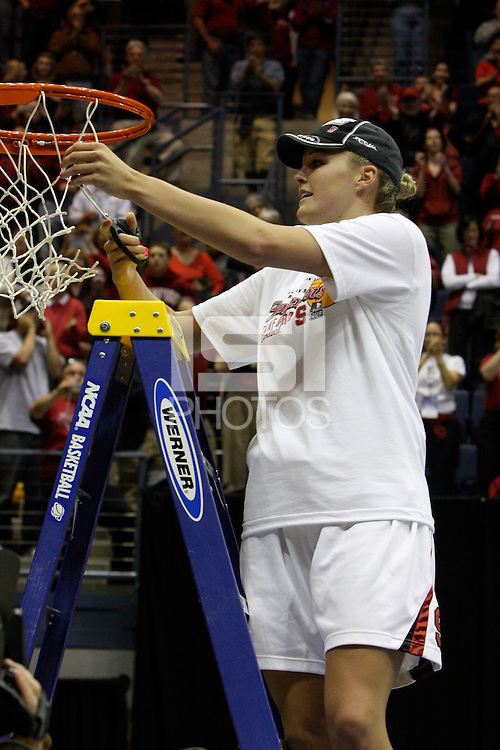 BERKELEY, CA - MARCH 30: Jayne Appel cuts down the net following Stanford's 74-53 win against the Iowa State Cyclones on March 30, 2009 at Haas Pavilion in Berkeley, California.
