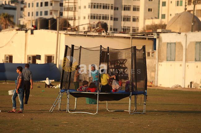 Palestinian children play at the Gaza seaport, on July 06, 2015. Photo by Ashraf Amra