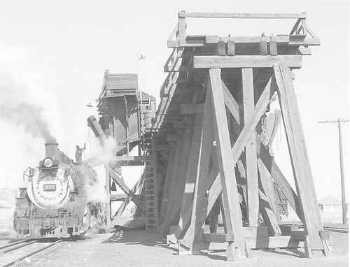 #491 taking coal at Antonito coaling trestle.<br /> D&amp;RGW  Antonito, CO  Taken by Richardson, Robert W. - 2/20/1956