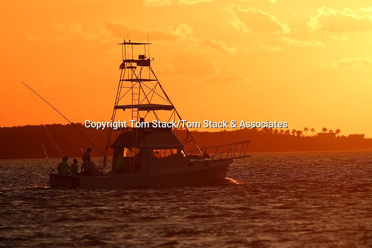 Sport fishing boat heading out into the Atlantic Ocean at daybreak, Florida Keys