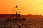 Sport fishing boat heading out into the Atlantic Ocean at daybreak, Florida Keys