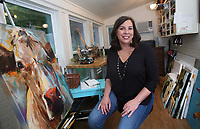 NWA Democrat-Gazette/DAVID GOTTSCHALK  Kari Tanneberger sits Thursday, June 15, 2017, in her art studio at her home in Fayetteville. Tanneberger led Fayetteville High School to back-to-back state girls basketball titles in 1993 and 1994. She scored 36 points ands grabbed 25 rebounds (still a state record) in the 94 championship game that went 8 overtimes, which was a national record at the time. She chose not to play basketball in college and lives in Fayetteville with her family. She has pursued a side career as an artitst.