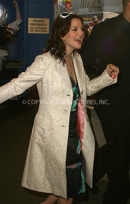 WWW.ACEPIXS.COM . . . . .  ....NEW YORK, APRIL 5, 2005....Drew Barrymore exiting TRL after promoting her new movie 'Fever Pitch.'....Please byline: PAUL CUNNINGHAM - ACE PICTURES..... *** ***..Ace Pictures, Inc:  ..Craig Ashby (212) 243-8787..e-mail: picturedesk@acepixs.com..web: http://www.acepixs.com