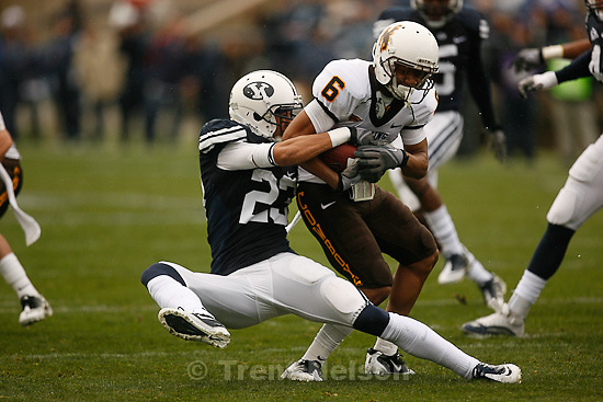 Trent Nelson  |  The Salt Lake Tribune.BYU defensive back Travis Uale (23) pulls down Wyoming's Robert Herron during the first half, BYU vs. Wyoming, college football Saturday, October 23, 2010 at LaVell Edwards Stadium in Provo.