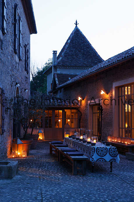 The sheltered inner courtyard to the manor house is the ideal space for a dinner al fresco