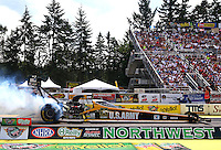 Aug. 2, 2014; Kent, WA, USA; NHRA top fuel driver Tony Schumacher during qualifying for the Northwest Nationals at Pacific Raceways. Mandatory Credit: Mark J. Rebilas-USA TODAY Sports