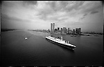 The S.S. France, passing the recently-completed World Trade Center, begins its final voyage.<br /> New York Harbor, USA, July 1974<br /> <br /> Le paquebot France lors de sa derni&egrave;re travers&eacute;e passe devant le World Trade Center tout juste achev&eacute;.<br /> Port de New York, USA, juillet1974<br /> <br /> Nikon F   24mm   Tri-x