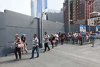 The first official public visitors begin to enter the National September 11 Memorial.