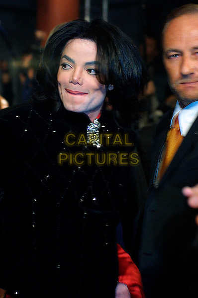 MICHAEL JACKSON .Michael Jackson dies at the age of 50 after suffering a heart attack on July 25th, 2009 .Bambi Awards, Estrel Hotel, Berlin, Germany..November 21st, 2002.half length black jacket .CAP/PPG/SCH.© Schnoor/People Picture/Capital Pictures