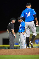 Hudson Valley Renegades manager Tim Parenton (12) argues a call with umpire John Budka as pitcher Spencer Jones (14) waits on the mound during a game against the Batavia Muckdogs on August 2, 2016 at Dwyer Stadium in Batavia, New York.  Batavia defeated Hudson Valley 2-1.  (Mike Janes/Four Seam Images)