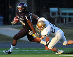 ROME, GA - DECEMBER 18: Chevon Walker #29 of the University of Sioux Falls looks to escape the grasp of Tucker Vezina  #27 from Carroll College in the first quarter at Barron Stadium in the 2010 NAIA National Football Championship in Rome, GA.(photo by Dave Eggen/Inertia)