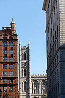 Historical office buildings and steeple of Notre Dame Basilica, Old Montreal Quebec, Canada