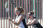 Santa Barbara, CA 02/18/12 - Sarah Lautman (Colorado #13) and Avi Feldman  (Cal Poly SLO #17) in action during the 2012 Santa Barbara Shootout.  Colorado defeated Cal Poly SLO 8-7.