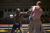 Obi Egbunike (black shorts) defeats William Warburton during a Boxing Show at York Hall on 30th November 2018