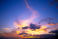 Sunset with clouds and moonrise