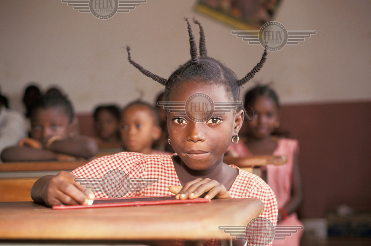 A primary school girl with a fabulous hair style.