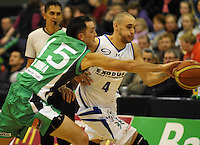 Jets guard Matt Te Huna steals off Lindsay Tait. NBL  - Manawatu Jets  v Wellington Saints at Arena Manawatu, Palmerston North, New Zealand on Friday 17 June 2011. Photo: Dave Lintott / lintottphoto.co.nz