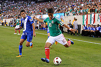 Giovani dos Santos (10) of Mexico is defended by Jonathan Lopez (24) of Guatemala. Mexico defeated Guatemala 2-1 during a quarterfinal match of the 2011 CONCACAF Gold Cup at the New Meadowlands Stadium in East Rutherford, NJ, on June 18, 2011.