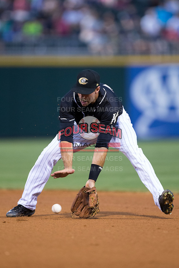 Charlotte Knights second baseman Ethan Wilson (12) on defense against the Gwinnett Braves at BB&T BallPark on August 11, 2015 in Charlotte, North Carolina.  The Knights defeated the Braves 3-2.  (Brian Westerholt/Four Seam Images)