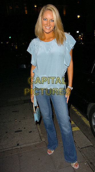 SARAH BOSNICH.The Advergamer Summer Party,.The Eve Club,.London 11th August 2005.full length denim jeans blue satin top belt handbag sandals shoes eye contact.www.capitalpictures.com.sales@capitalpictures.com.©Capital Pictures