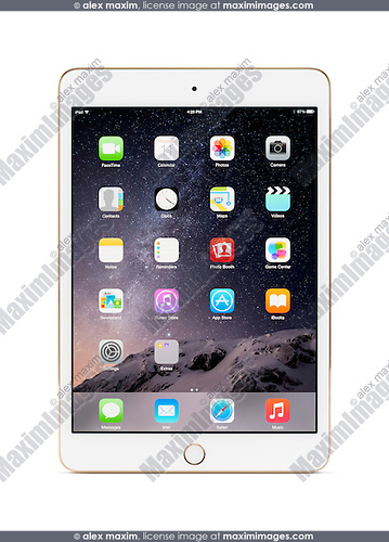 White gold Apple iPad Mini 3 tablet computer with desktop icons on its display. Isolated with clipping path on white background.