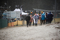 Fans start fleeing from the side of the course and into the (huge party) tents as a rainstorm floods the circuit.<br /> A few hardcore fans remain.<br /> <br /> Women U23 Race<br /> UCI 2016 cyclocross World Championships