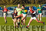 Kerry's Lorraine Scanlon in action as she clears her defence, despite the effort from Mayo's Clodagh McManaman in the Lidl Ladies National football league game in Brosna on Sunday last.