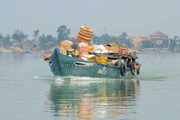 Asia, Vietnam, near Hoi An. Well loaded barge on the Thu Bon river near Hoi An.