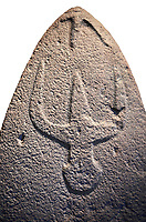 Late European Neolithic prehistoric Menhir standing stone with carvings on its face side. The representation of a stylalised male figure starts at the top with a long nose from which 2 eyebrows arch around the top of the stone. below this is a carving of a falling figure with head at the bottom and 2 curved arms encircling a body above. Excavated from Genna Arrele II. Menhir Museum, Museo della Statuaria Prehistorica in Sardegna, Museum of Prehoistoric Sardinian Statues, Palazzo Aymerich, Laconi, Sardinia, Italy. White background.