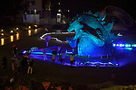 """July 18, 2014, Tokyo, Japan - People take pictures of the 6.6 meter model of the new Godzilla at Tokyo Midtown on July 18, 2014, Tokyo. The statue is a 1/7 scale reproduction of the 180 meters tall Hollywood film version of """"GODZILLA"""".  Godzilla and its footprints will be displayed from July 18 to August 31 during which time it will perform a special show using mist, light and sound effects every 30 minutes between 19:00 to 21:00. (Photo by Rodrigo Reyes Marin/AFLO)"""