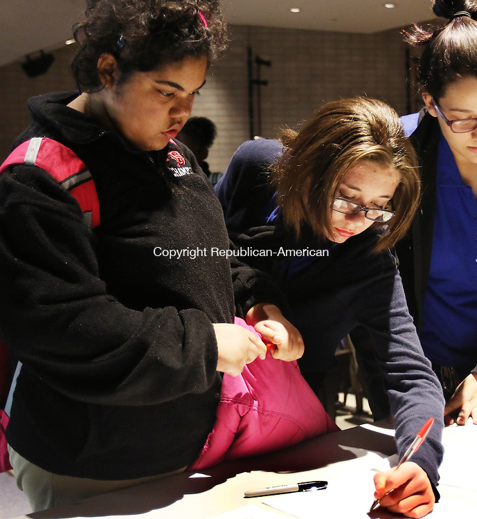 WATERBURY CT. 08 November 2016-110816SV07-From left, Alyson Saunders, 15, and Gabriella Melendez, 14, both of Waterbury signup for the VOICES Club at Crosby High School in Waterbury Thursday. VOICES stands for Victory Over Injustice Through Commitment Enrichment Services. <br /> Steven Valenti Republican-American