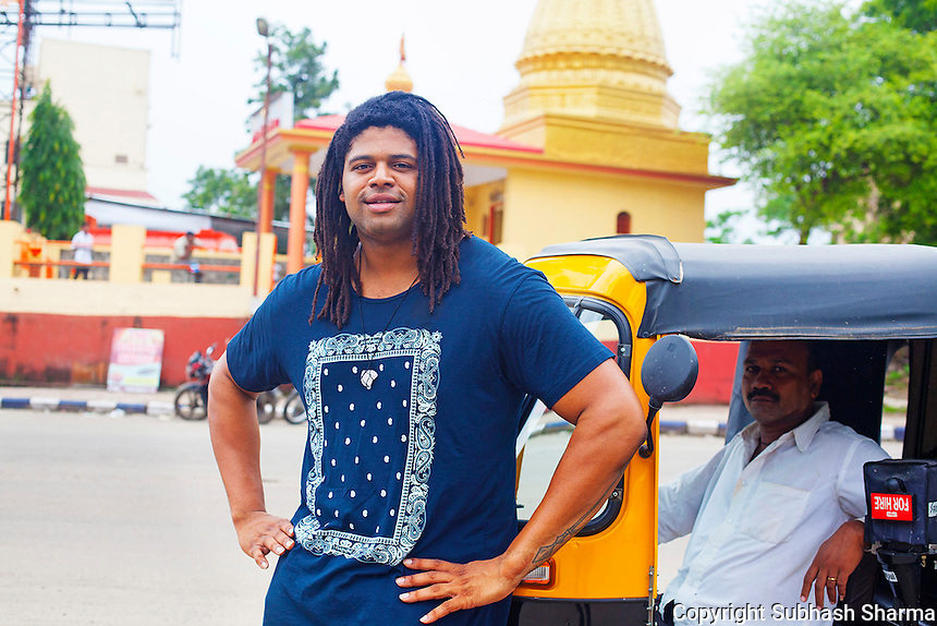 14 July 2016 - Pune - INDIA.<br /> Jamal Idris hails a tuktuk locally known as Rickshaw  outside a Temple at Pune.<br /> <br /> (Subhash Sharma for the Sunday Telegraph)