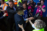 Cardiff owner Vincent Tan makes it to the tunnel after battling through fans celebrating on the pitch after the Sky Bet Championship match between Cardiff City and Reading at the Cardiff City Stadium, Cardiff, Wales on 6 May 2018. Photo by Mark  Hawkins / PRiME Media Images.
