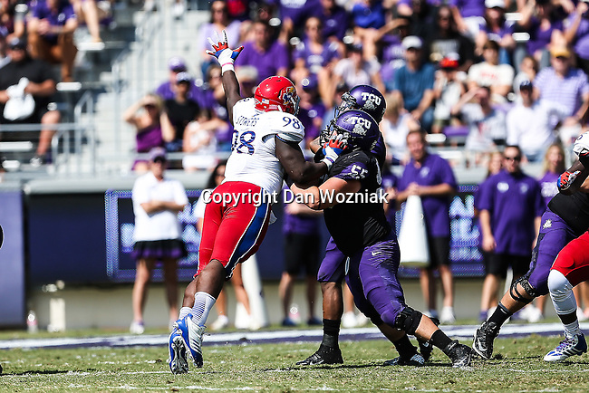 TCU Horned Frogs and Kansas Jayhawks players, cheerleaders and fans in action during the game between the Kansas Jayhawks and the TCU Horned Frogs  at the Amon G. Carter Stadium in Fort Worth, Texas.