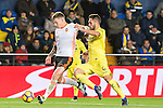Santiago Mina Lorenzo, Santi Mina, (c) of Valencia CF battles for the ball with Víctor Ruiz Torre (r) of Villarreal CF during their La Liga match between Villarreal CF and Valencia CF at the Estadio de la Cerámica on 21 January 2017 in Villarreal, Spain. Photo by Maria Jose Segovia Carmona / Power Sport Images