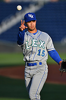 Right fielder Amalani Fukofuka (15) of the Lexington Legends warms up prior to a game against the Greenville Drive on Wednesday, April 12, 2017, at Fluor Field at the West End in Greenville, South Carolina. Greenville won, 4-1. (Tom Priddy/Four Seam Images)