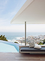The contemporary home has a relaxed, peaceful quality with a seamless connection between indoor and outdoor living. The cantilevered terrace overlooks the infinity pool and makes the most of the spectacular view.